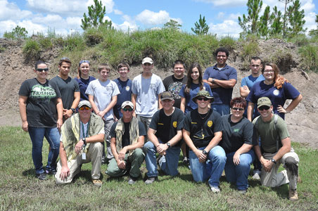 Picture of Police Explorers and Adults at Gun Range for training.