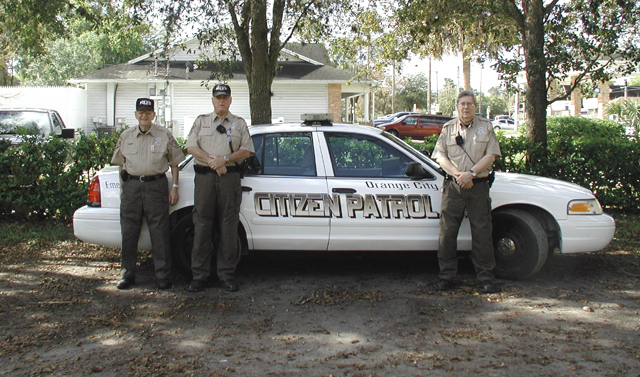 Picture of Volunteers posting in from of Citizens Patrol Vehicle