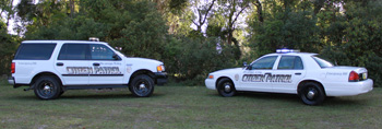 Picture depicting Volunteer SUV and Patrol Car.
