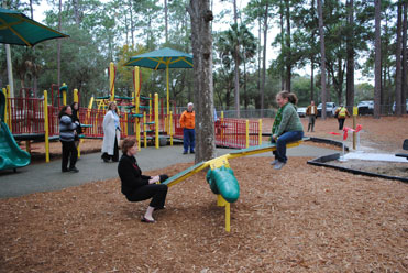 Picture of children playing on playground equipment.